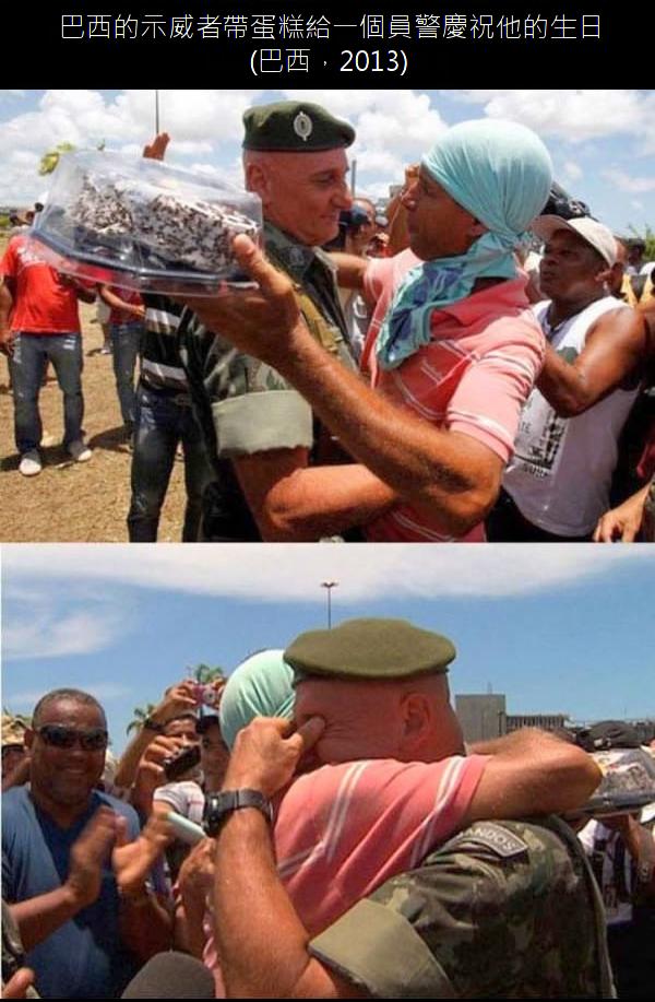 13.巴西的示威者帶蛋糕給一個員警慶祝他的生日.13.png