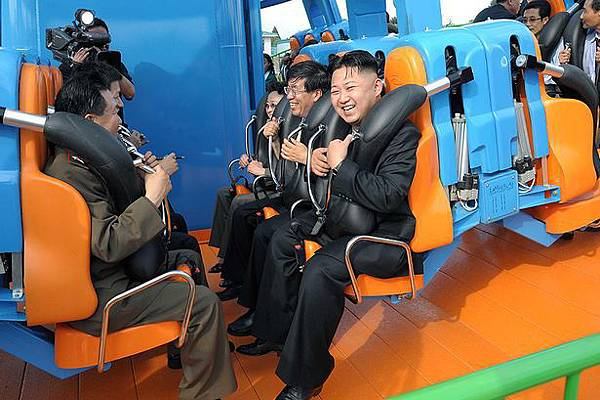 Kim Jong Un reacts on a ride as he attends the completion ceremony of the Rungna People