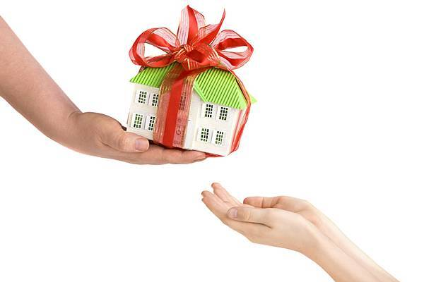 Adults-Hand-Giving-Childs-Hands-a-Model-of-the-House
