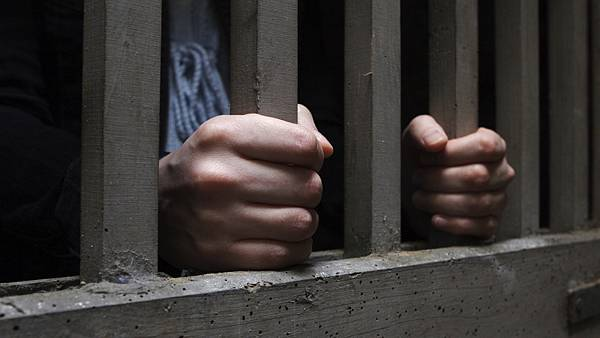 istock-3504307-jail-bars-hands_wide-0150ad1525ed10ac6f7fab0390a1f6c46ad7c886