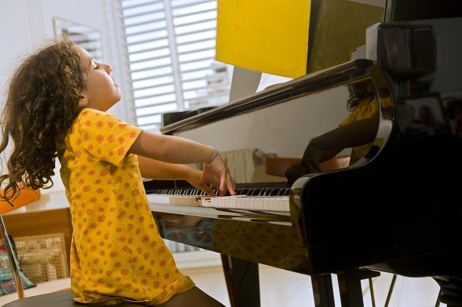 bigstock-Little-Girl-Playing-The-Piano-37198631.jpg