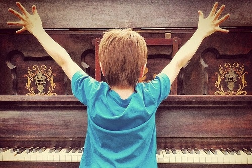 kid playing piano_Flickr_by CarrieMonster.jpg