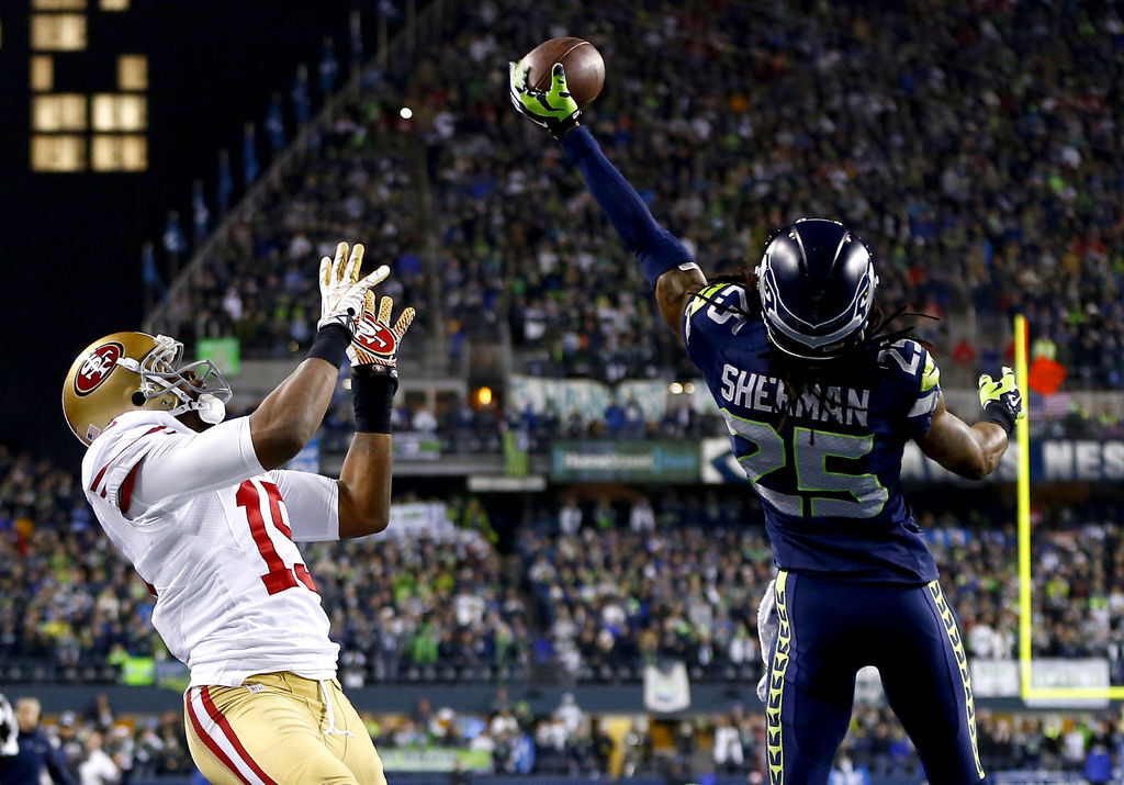 Richard-Sherman-blocking-a-pass