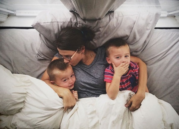 mom_and_sons_snuggling_in_bed.jpg