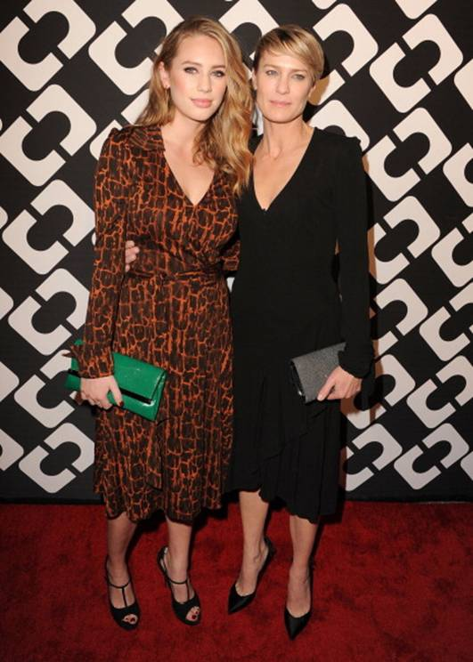 Dylan-Penn-in-a-vintage-DVF-Wrap-Dress-and-440-Envelope-Clutch-Robin-Wright-in-a-DVF-Wrap-Dress.jpg