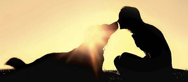 woman-kissing-dog-sunset.jpg