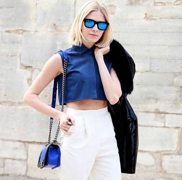WHO-WHAT-WEAR-PARIS-FASHION-WEEK-FW-2013-STREET-STYLE-BLUE-MIRRORED-SUNGLASSES-ELENA-PERMINOVA-RUSSIAN-BLONDE-CROPPED-COLLARED-DENIM-SHIRT-HIGH-WAIST-WHITE-PANTS-TROUSERS-CHANEL-BAGFUR-HOODED-PARKA