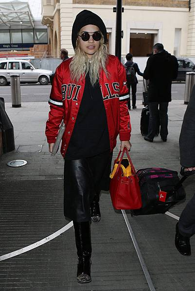 Rita-Ora-took-her-sporty-Chicago-Bulls-jacket-cozy-heights-via-black-knit-beanie-studded-boots