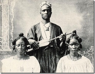 Griot with Two Women Conakry
