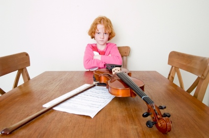 an angry girl with her violin