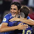 Italian forward Luca Toni (L) and Italian midfielder Francesco Totti celebrate at the end of the Wor