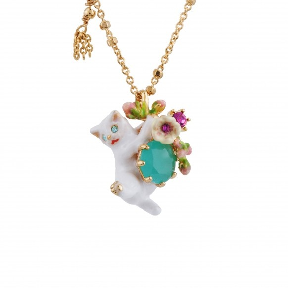 cat-grabbing-flowers-blue-stone-and-charms-necklace