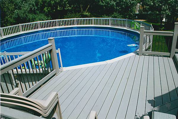 Round-above-ground-composite-pool-with-decks-railing.jpg