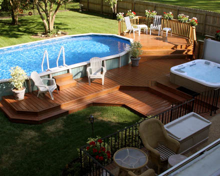 Oval-above-ground-pool-deck-off-house-with-outdoor-furniture.jpg