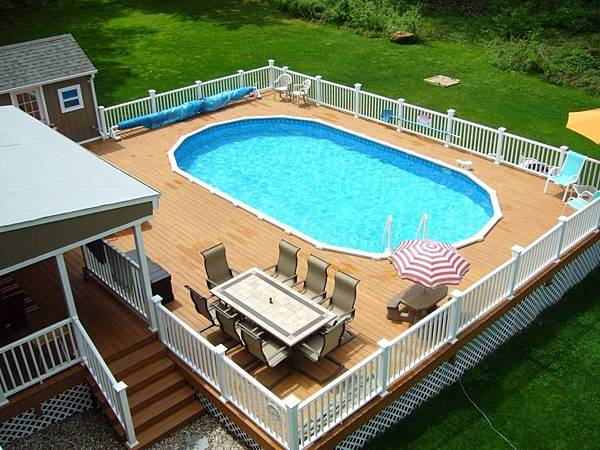 Oval-above-ground-swimming-pools-with-wooden-decks-and-white-railing.jpg