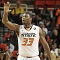 hi-res-450562445-marcus-smart-of-the-oklahoma-state-cowboys-calls-a-play_crop_exact.jpg
