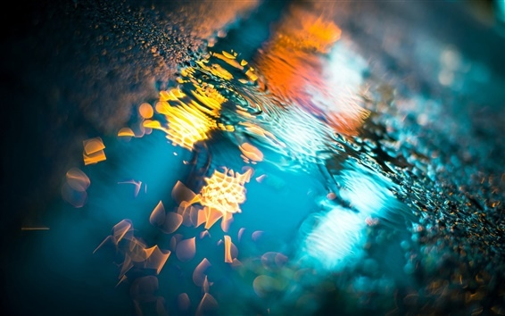 Colorful-lights-after-the-rain-the-ground-water-reflection_m