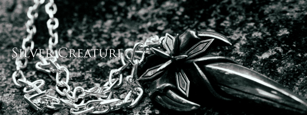 1010_380-top_silver_creature