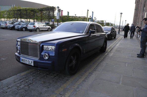 Djibril Cisse and his wife Jude Littler, arrive in their new Rolls Royce at Liverpool's Albert Dock for a night out..bmp