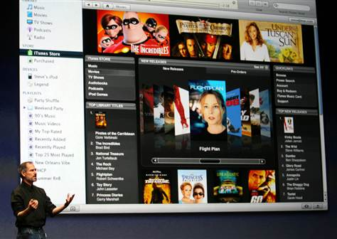 Apple Chief Executive Steve Jobs introduces full-length, high-resolution movie downloads from the iTunes website to a crowd at the Apple media center last fall.