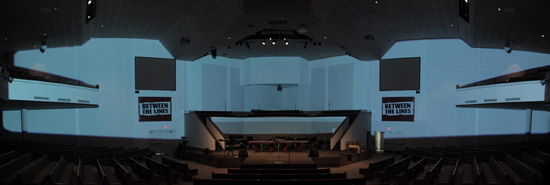 The masked area blocks projector light from screens, choir area, main seating, balconies, and ceiling elements.