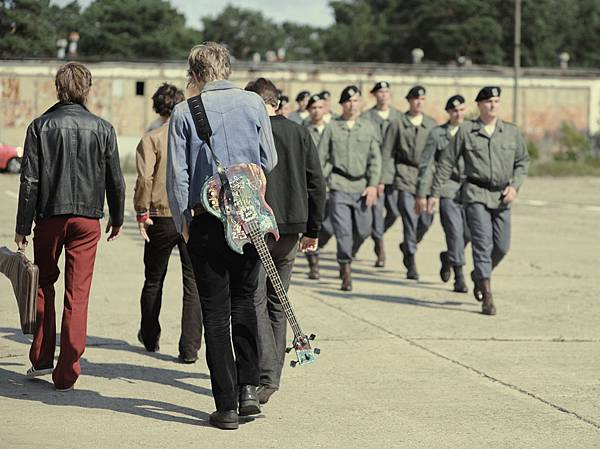Band_on_the_way_to_rehearsal_at_army_barracks-(1).jpg