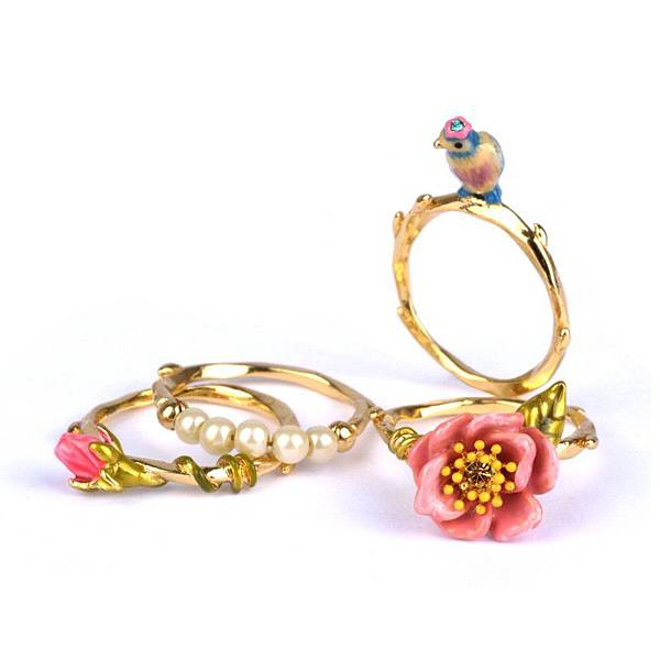 four-rings-with-tit-flower-bead-and-bud (1).jpg