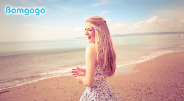 Happy girl woman beautiful blonde sea be2ach.jpg