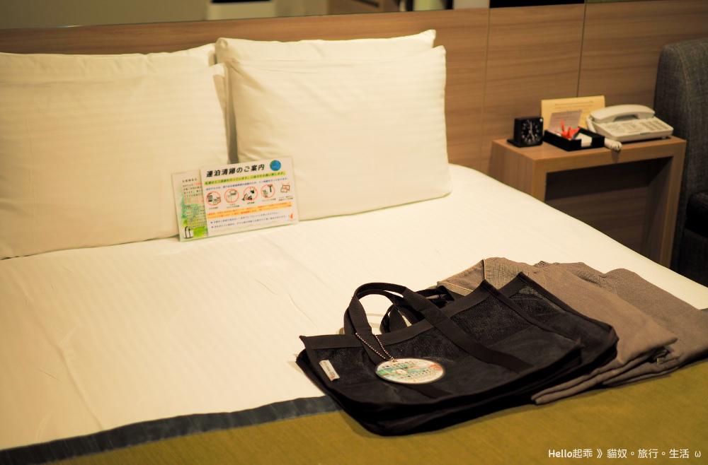 阿爾蒙特飯店床與工務服.jpg