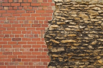 6763513-wall-from-old-stones-and-new-bricks