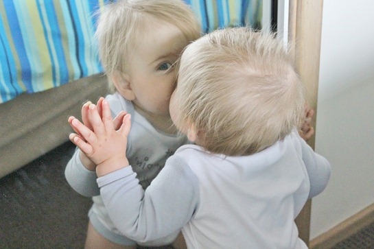 baby kissing mirror
