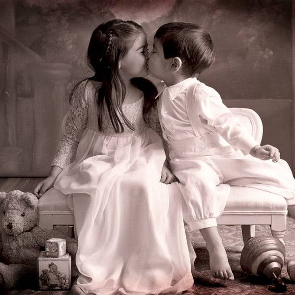 baby couple kissing