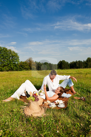 cutcaster-photo-100805075-Picnic-Romantic-couple-in-spring-nature.jpg