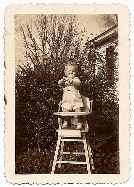 baby standing on the high chair