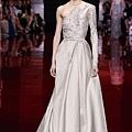 elie-saab-fall-2013-2014-couture-one-shoulder-long-sleeve-beige-gown.jpg