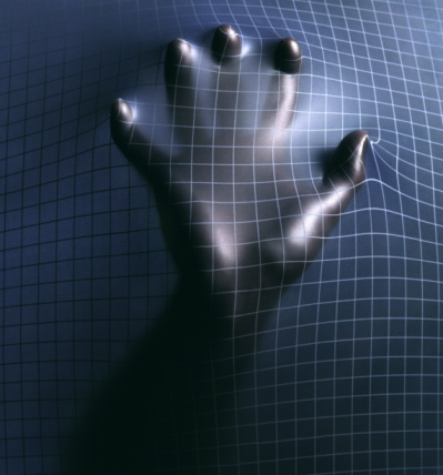 hand through metallic grid.jpg