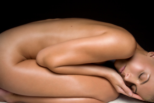 naked woman in fetal position.jpg