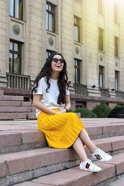 woman-wearing-white-shirt-and-yellow-skirt-sitting-on-brown-983564.jpg