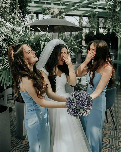 bride-holding-bouquet-of-flowers-with-her-bridesmaids-4334407.jpg