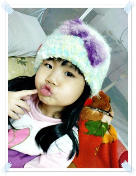 鉤針棉花糖帽~帽子的裝飾是紫色大的蝴蝶結