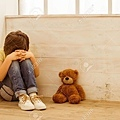 52069679-punished-little-boy-sitting-in-the-corner-and-crying-a-teddy-bear-lying-near-him