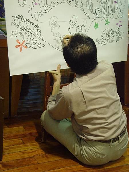 阿彬叔叔在示範畫上簽名.JPG