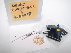▲卡片內有李敏鎬簽名和他手寫的「新年快樂」等字樣。(葉宜欣攝).jpg