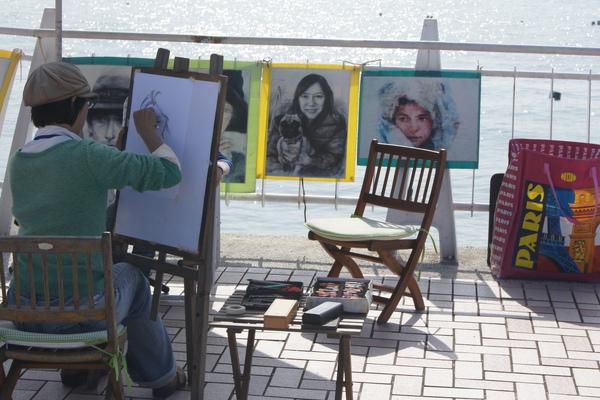 街頭畫家在淡水漁人碼頭