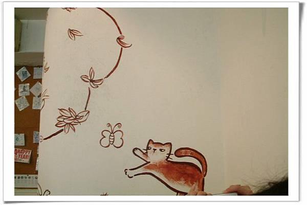 店內牆上貓畫像