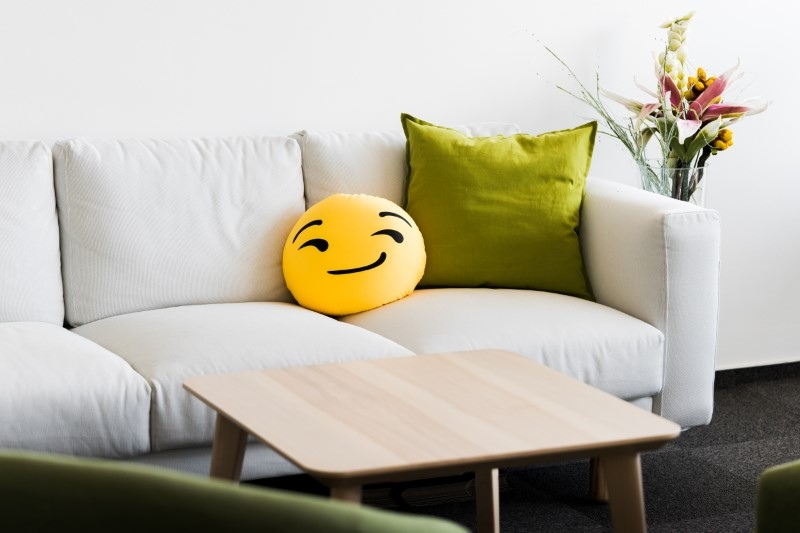 white-office-couch-with-funny-emoji-pillow-picjumbo-com.jpg