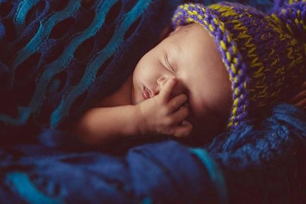 incredible-and-sweet-newborn-baby-sleeps-in-basket_1304-3624.jpg