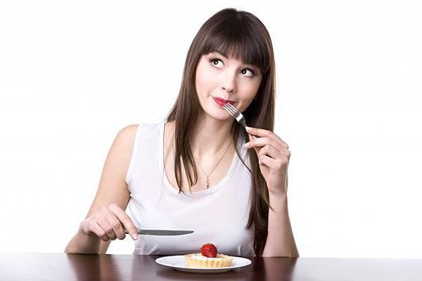woman-eating-a-cake_1163-1040.jpg
