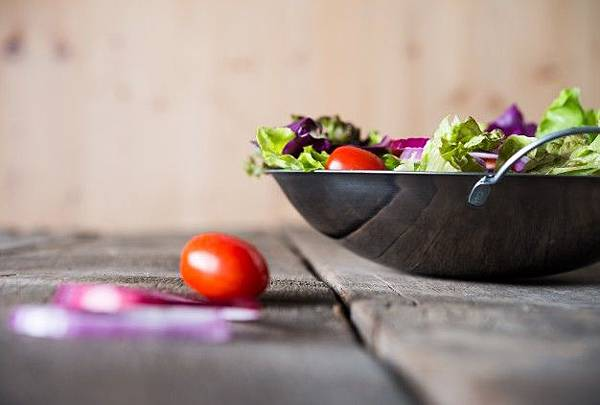 close-up-of-fresh-vegetables-salad-in-the-bowl-with-rustic-old-wooden-background-healthy-food-concept_1150-1838.jpg