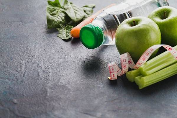 close-up-of-healthy-food-with-water-bottle-and-tape-measure_23-2147601749.jpg